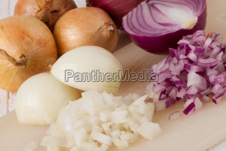 white and red onions are peeled