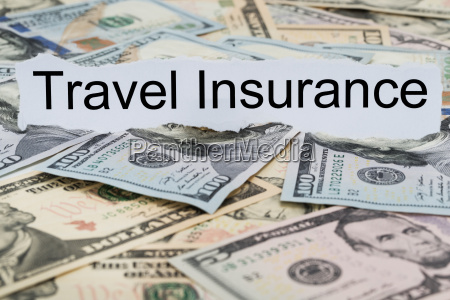 travel insurance text on piece of