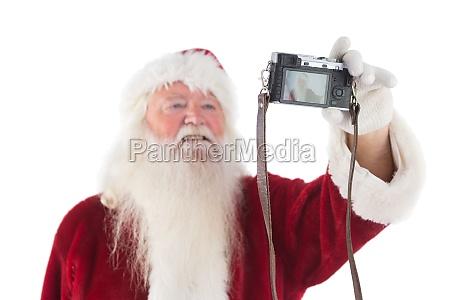 weihnachtsmann macht einen selfie