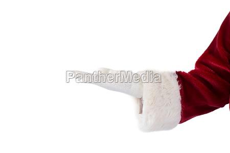 der weihnachtsmann praesentiert etwas mit seiner