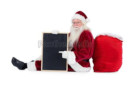 santa sitzt auf seine tasche mit