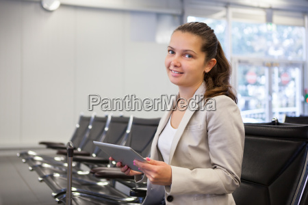 businesswoman using tablet computer at airport