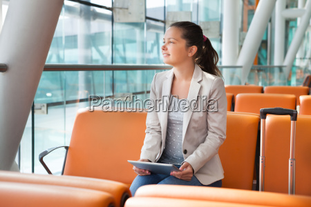 businesswoman with digital tablet waiting at