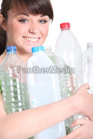 brunette recycling plastic bottles
