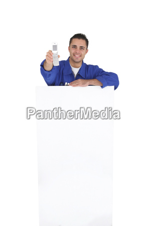 tradesman holding a mobile phone over