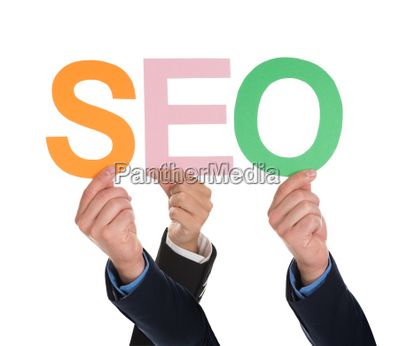 multiple hands holding seo word