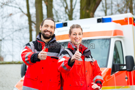 emergency doctor and paramedics in front