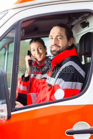 notartzt and paramedic driving ambulance