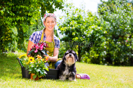 woman in garden with flowers and
