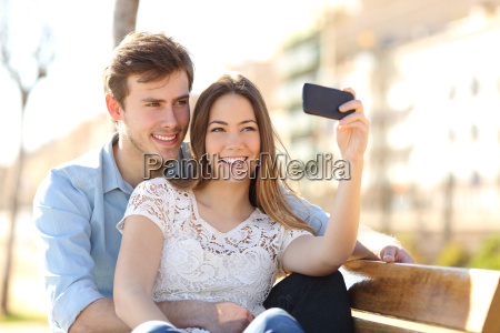 couple photographing a selfie with a