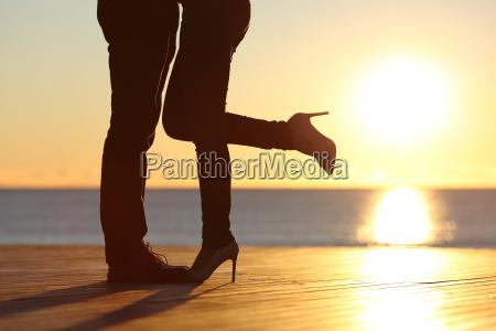 couple legs hugging in love on