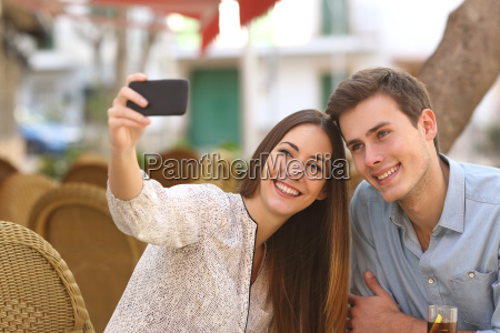 couple taking a selfie photo in
