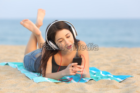 teen girl listening music and singing