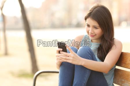 teen girl using a smart phone