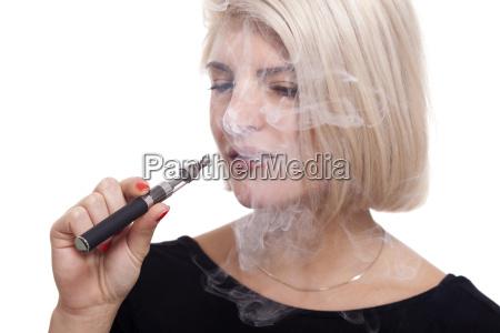 young woman smoking a e cigarette