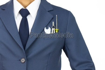 businessman with wrench and compass and