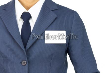 businessman stick business card at chest