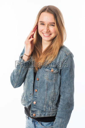 girl in jeans with a mobile
