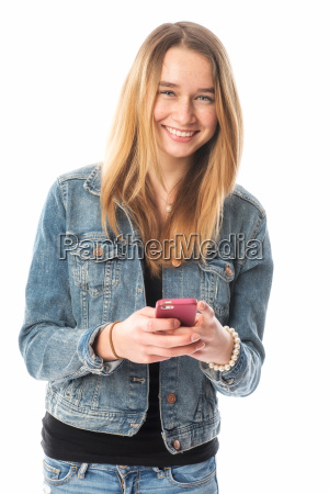 girl in jeans texting by mobile