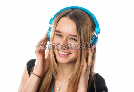 teenagers with headphones smiles
