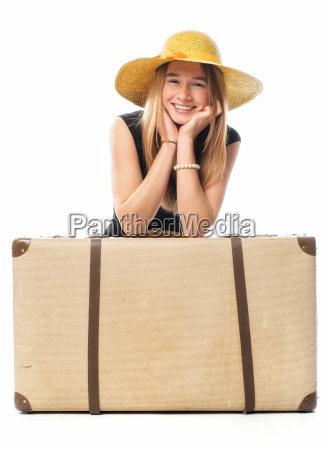 girl with straw hat sitting behind
