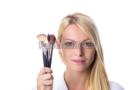 young woman with make up brush