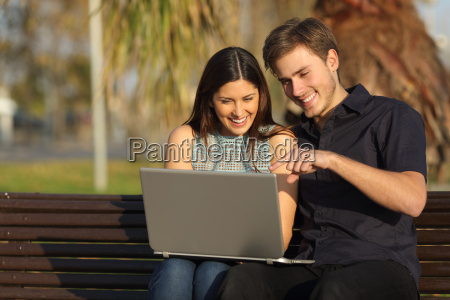couple watching media in a laptop