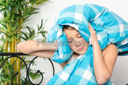 woman bed irritated headache ring to
