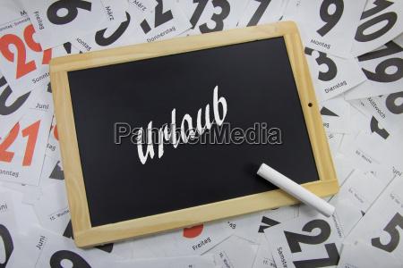urlaub auf eine tafel geschrieben