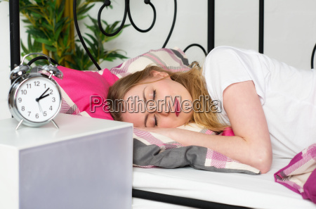 blonde young woman is calmly asleep