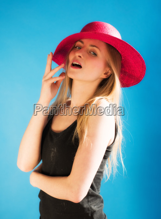 arrogant girl with red summer hat