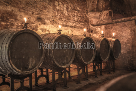 old barrels in the wine cellar