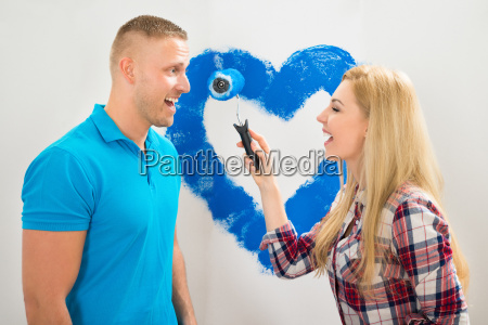 couple having fun while painting