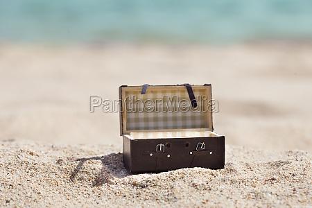 open suitcase on beach