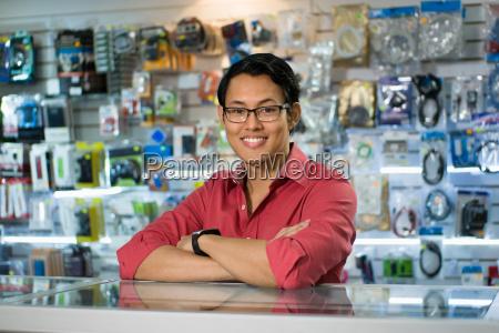 chinese man working as clerk sale