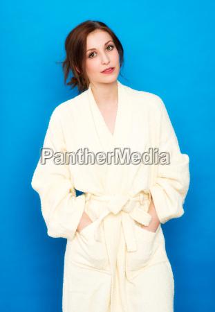 brunette woman in white bathrobe on