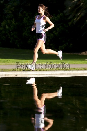 an athletic woman running next too