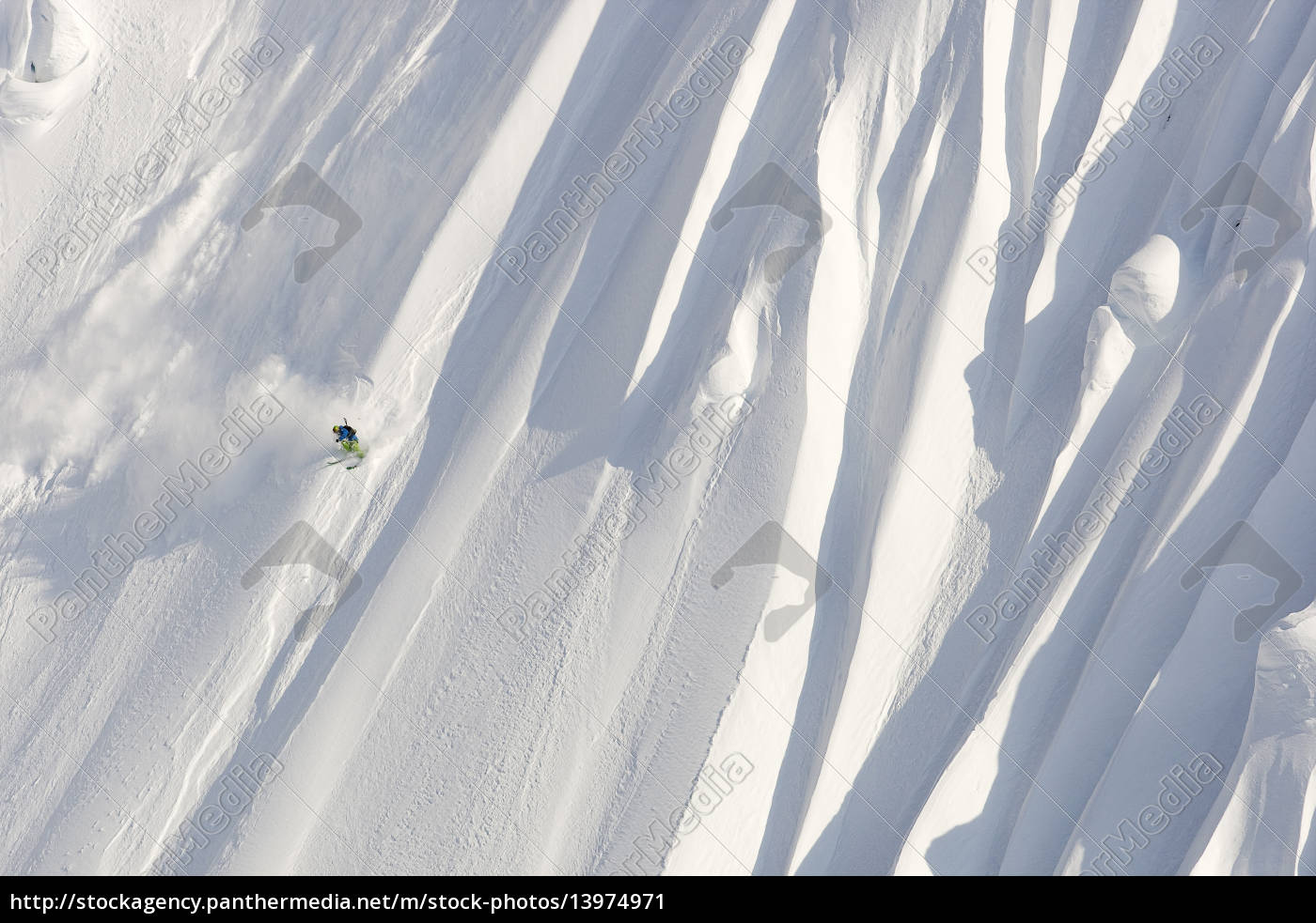 a, male, skier, skis, a, huge - 13974971
