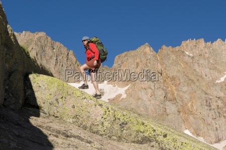 a woman hiking near upper sunlight
