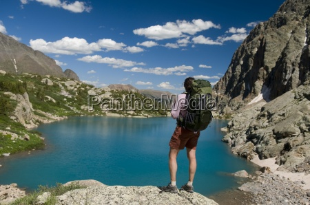 a woman hiker rests next to