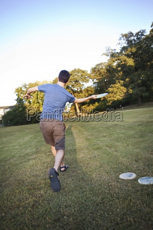 a man makes a forehanded throw