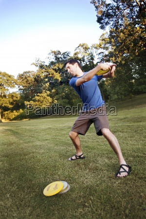 a man makes a backhanded throw