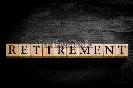 word retirement isolated on black background