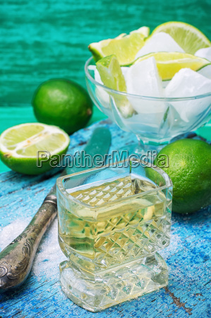 alcoholic cocktail with additions of lime