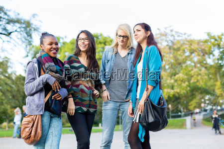multiracial friends standing as a group