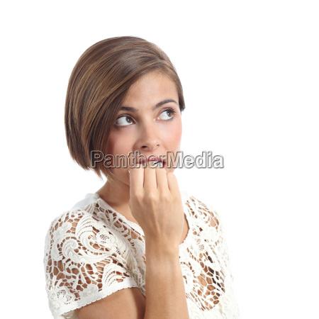 nervous pensive woman biting nails