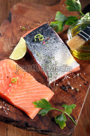 raw salmon fish meat on cutting