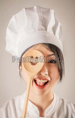 happy chef covering one eye with