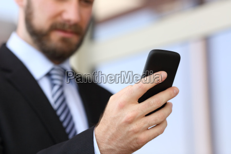 executive hand using a smartphone in