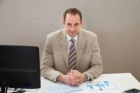 businessman with gantt chart sitting at